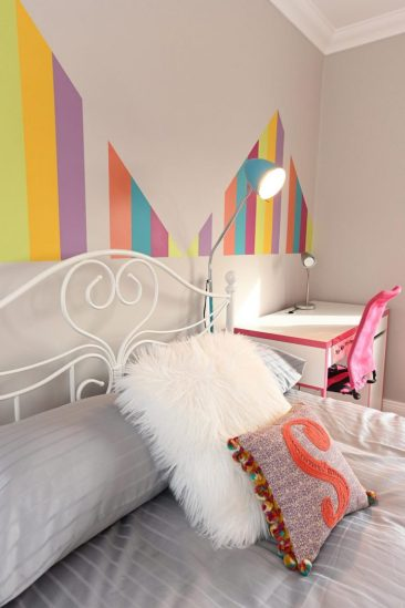 Childs bedroom design with rainbow wall colour pattern