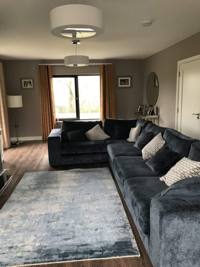 Midnight blue corner sofa in living room design