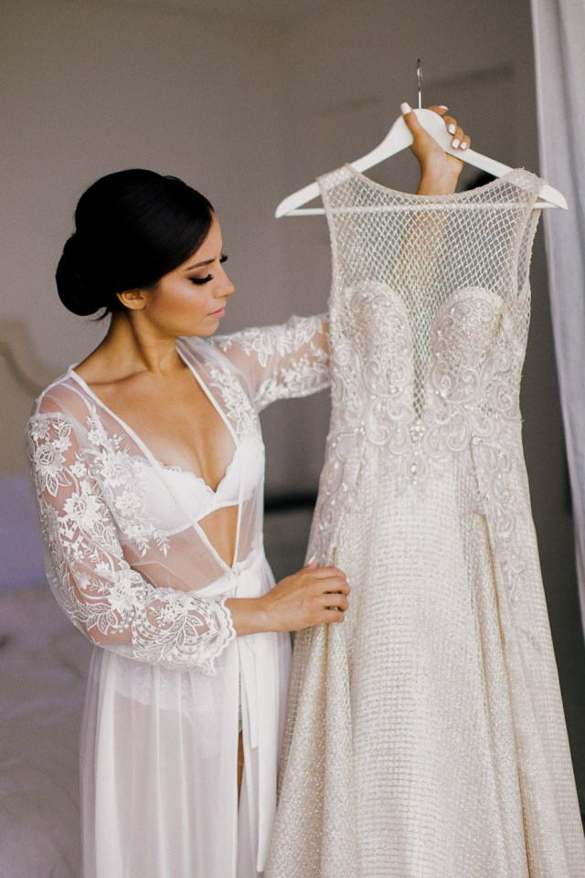 Bride is looking at her wedding dress