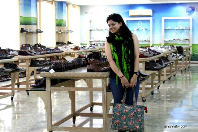 Happy to pose with the display arena. A room filled with shoes is a women's dream.