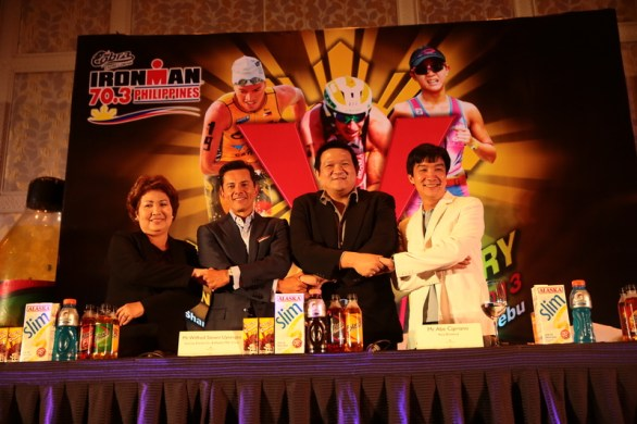 Lapu-Lapu City Mayor Paz Radaza, Mr. Wilfred Steven Uytengsu, Jr., Sunrise Events Inc. President and Alaska Milk Corp. CEO, Cobra Energy Drink AVP Mr. Abe Cipriano, and world-renowned industrial designer and a Cebuano, Mr. Kenneth Cobunpue, joining their hands as they pose for the media.
