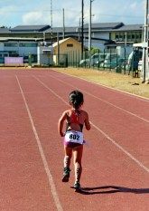 This little kid is unstoppable, even after she already crossed the finish line.
