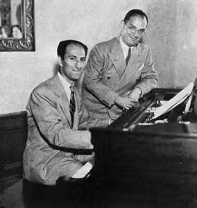 Brothers George and Ira Gershwin George is sitting at the piano