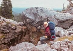 Posing at the canyon-lodged boulder.