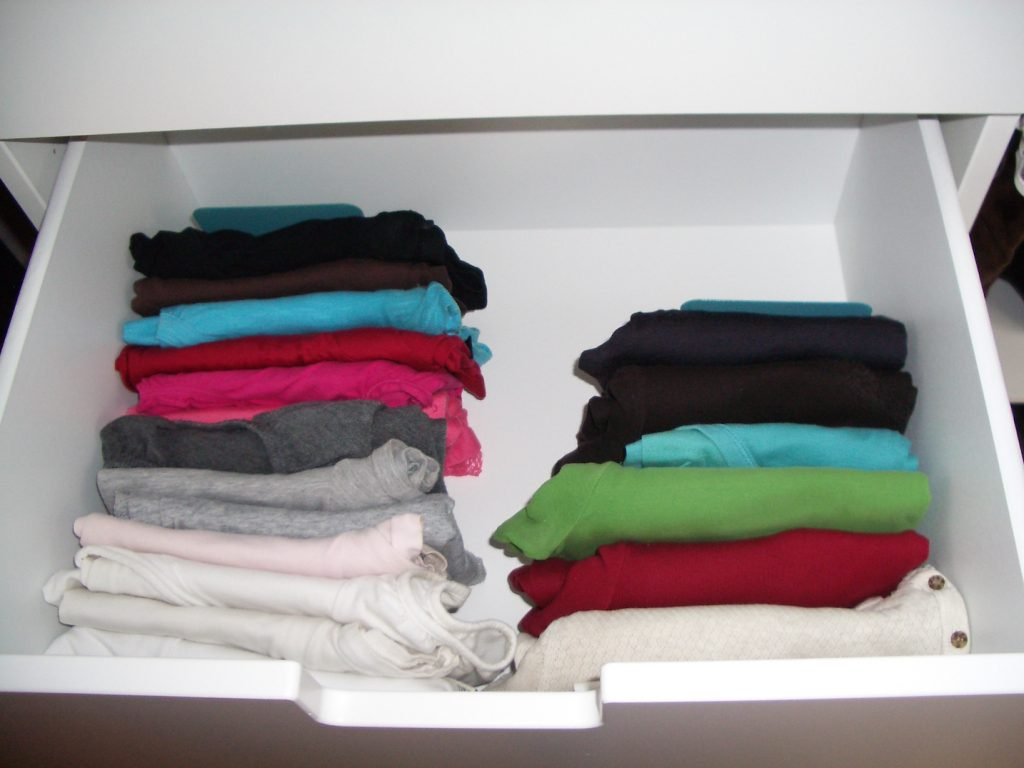 rolled up t-shirts in a drawer