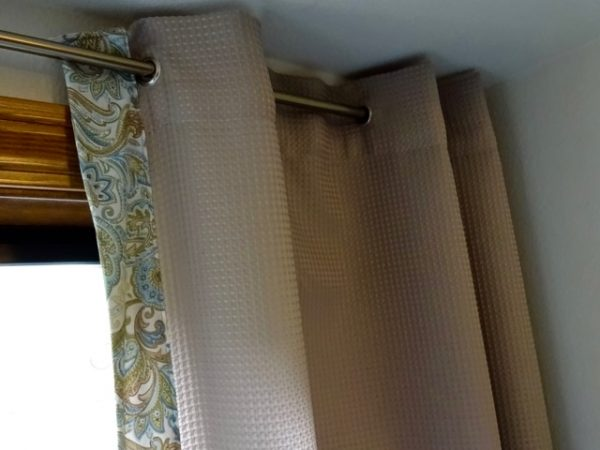 Make drapes from a shower curtain