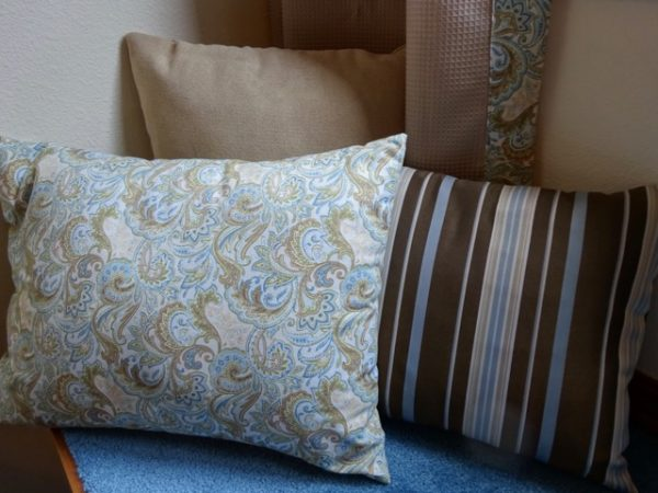 accent pillows covered in fabric on couch