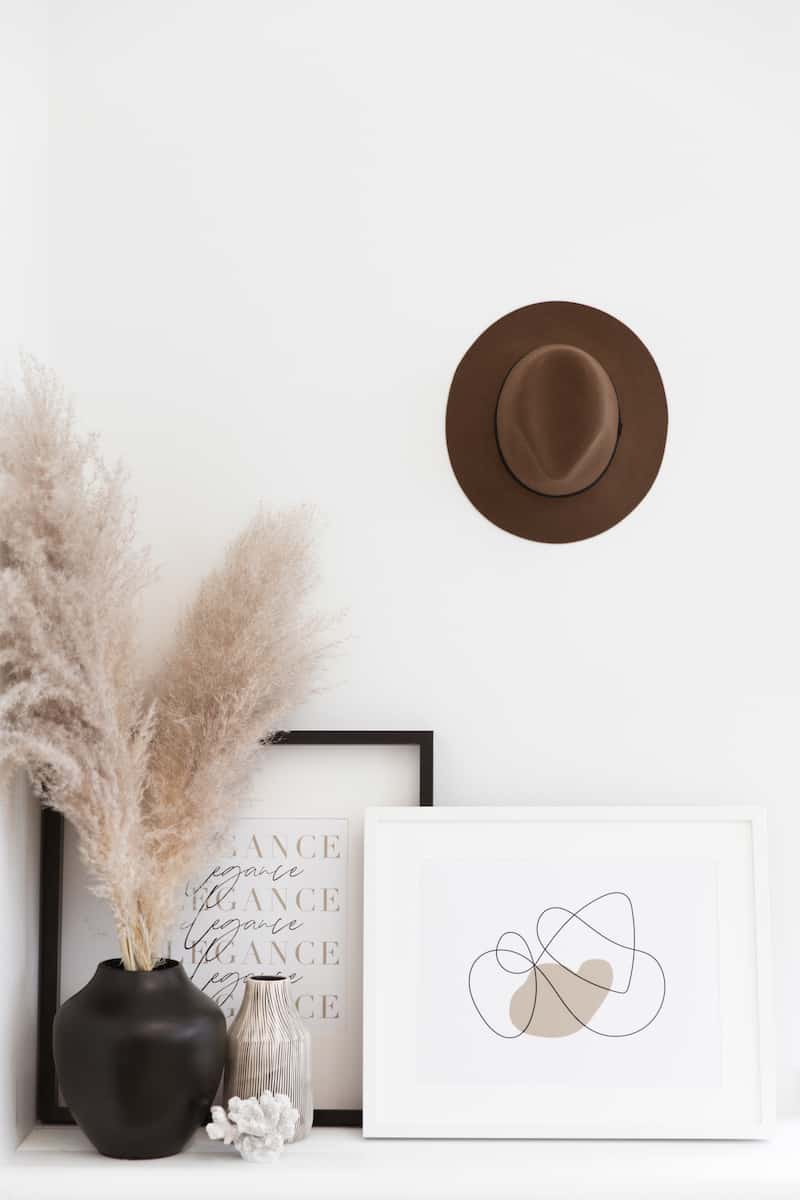 hat hanging on hook on wall in office