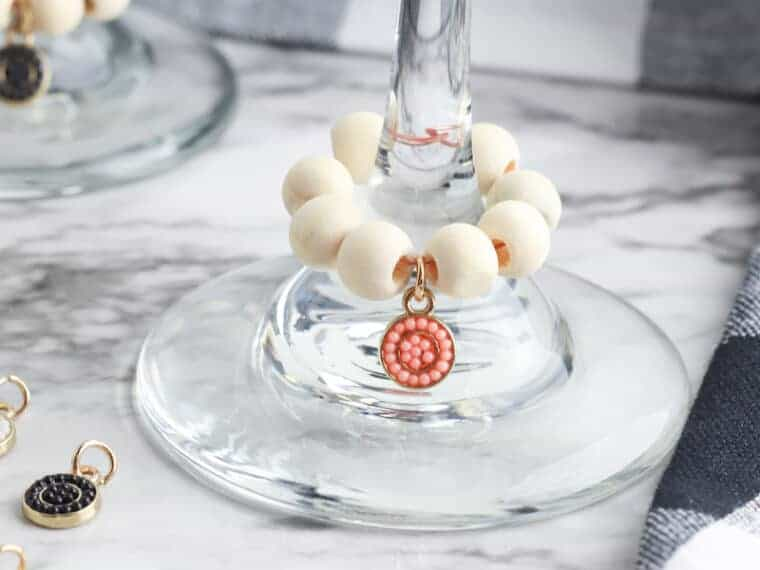 party drink charms on wine glasses on marble table