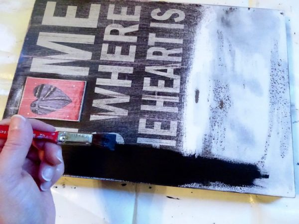 painting a sign with black paint