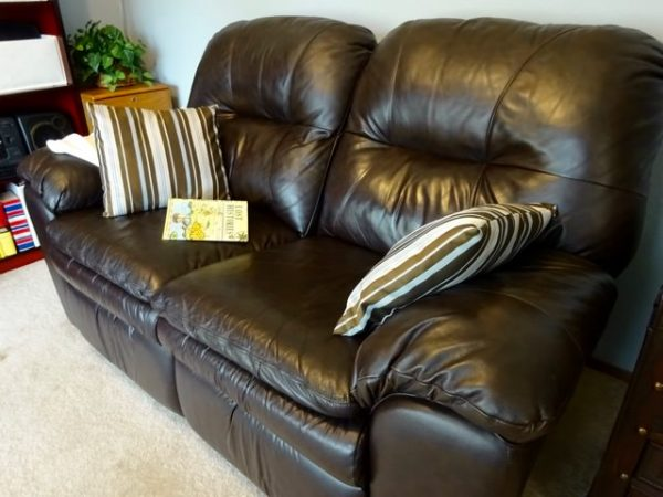 Reclining leather love seat