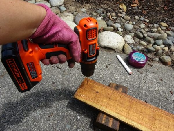 Drilling holes into a fence rail to prevent splitting