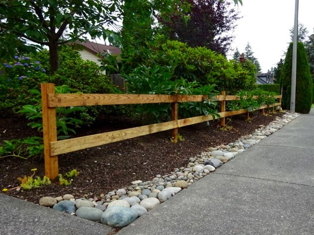 Two rail wood fence makes a flower garden border