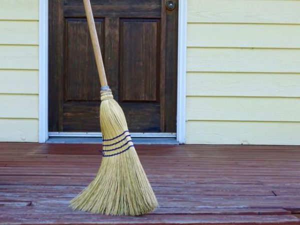 Sweeping a deck before refinishing
