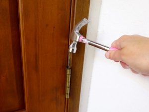 Reattach a door to the hinges