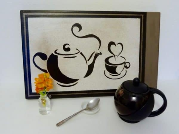 Painted teapot sign