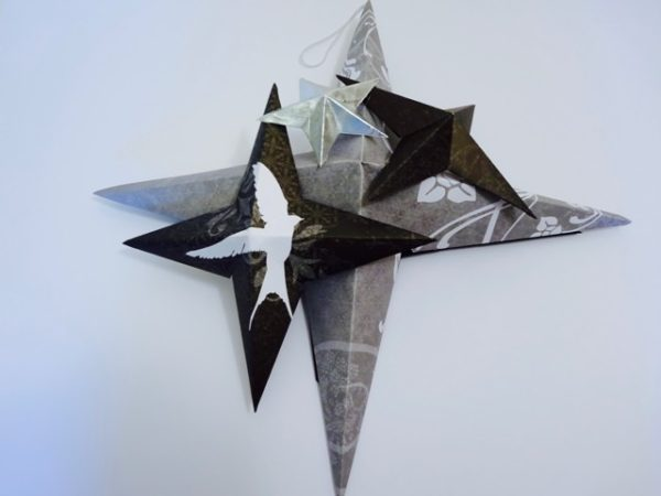 Folded paper stars wall hanging
