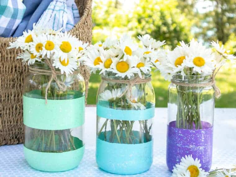 painted mason jars with acrylic paint stripes full of daisies