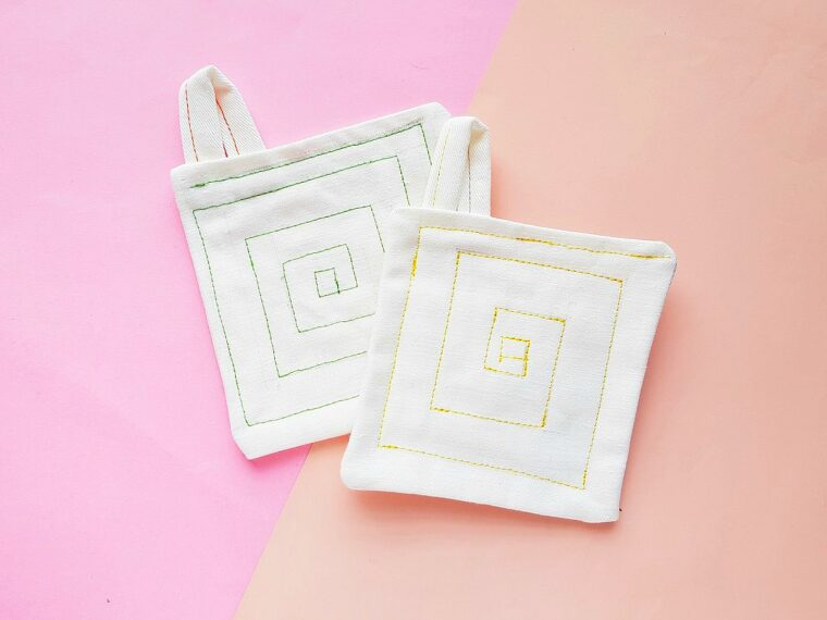 drop cloth pot holders against pink background