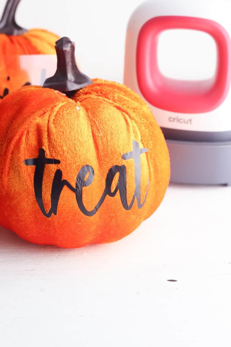applied cricut vinyl letters to plush pumpkin
