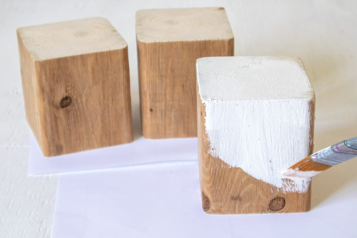 painting wood blocks with white paint