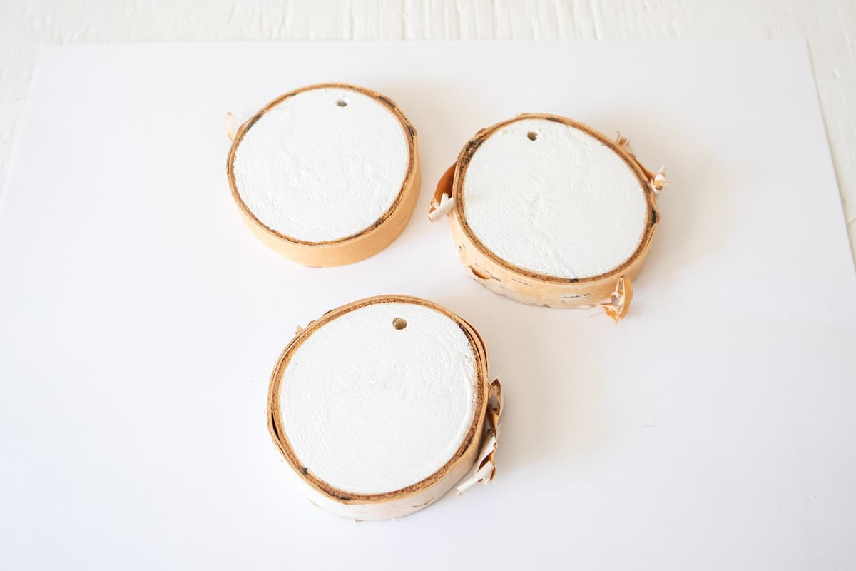 white painted wood slices on table
