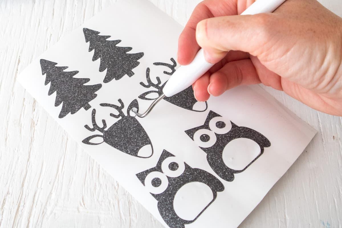Cricut tool removing Glitter Vinyl Christmas stencils