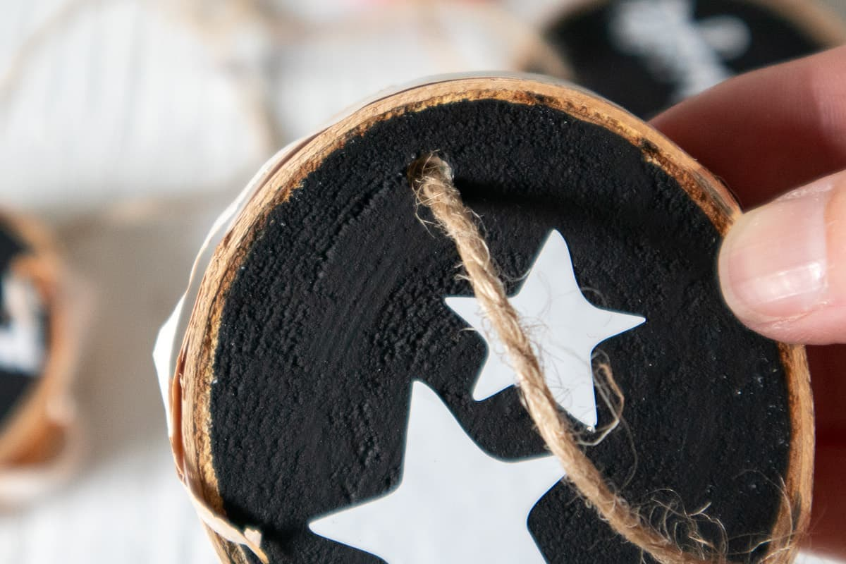 close up of lettered wood slice ornament