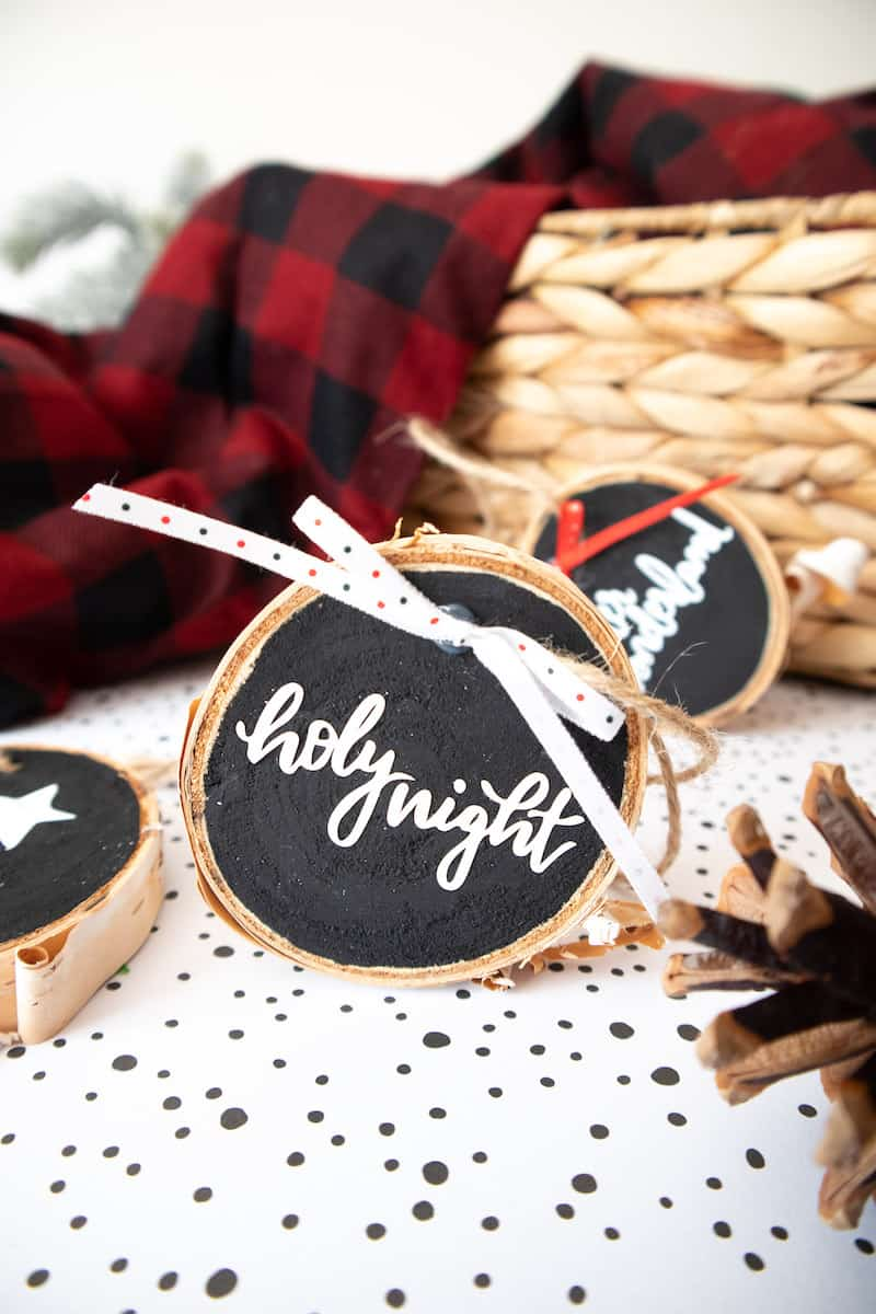 Lettered wood slice ornament with twine and fabric bows