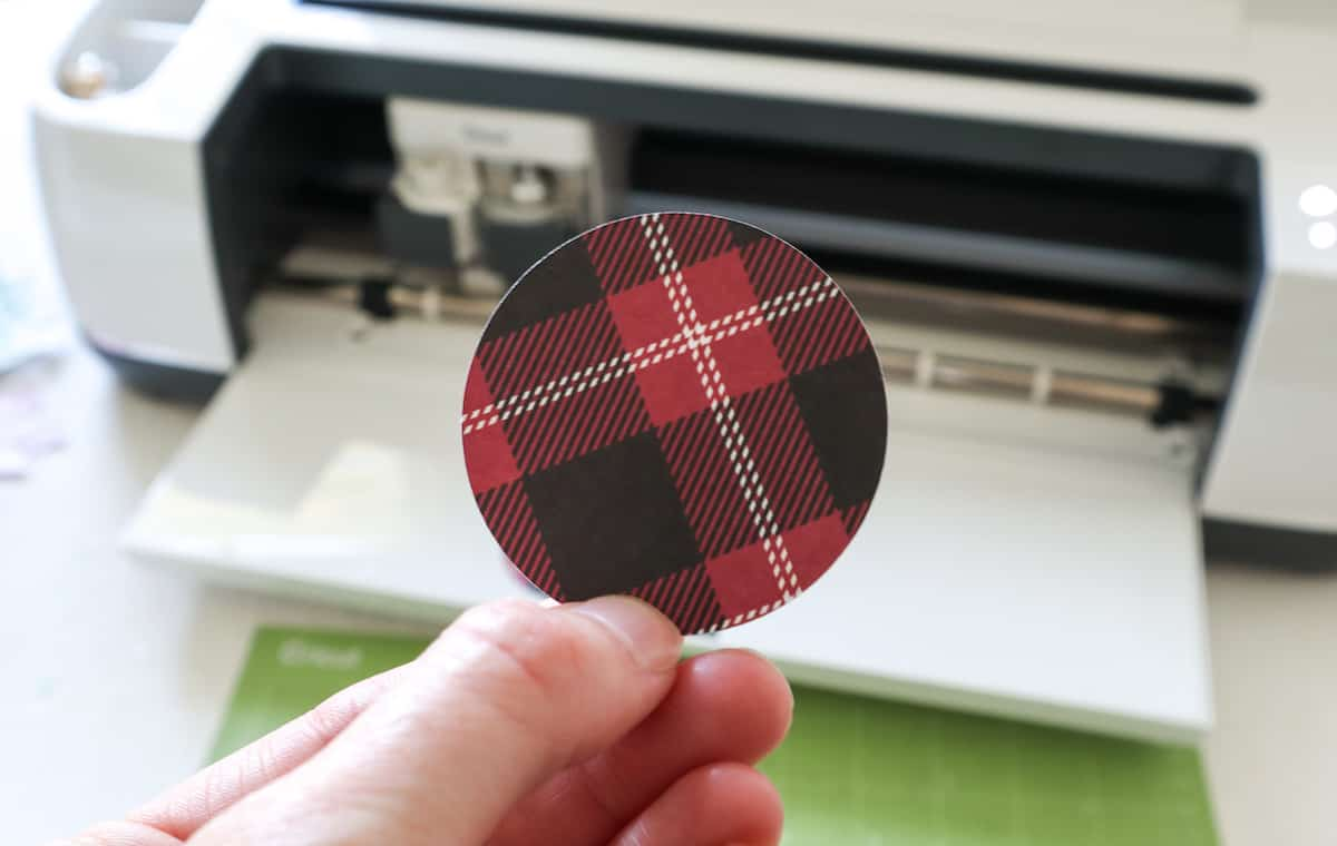 buffalo check plaid holiday jar topper in hand