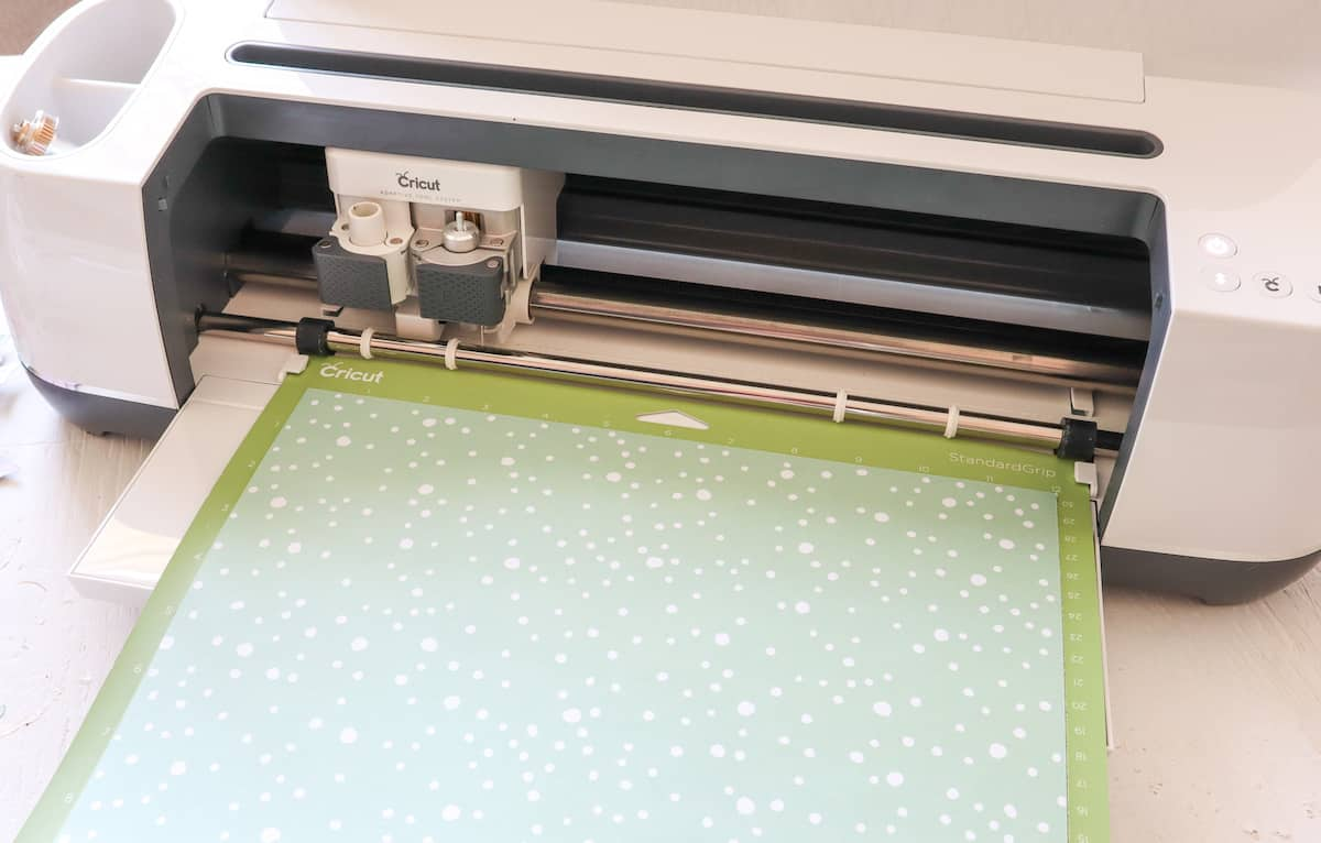 Cricut machine with holiday paper sheet
