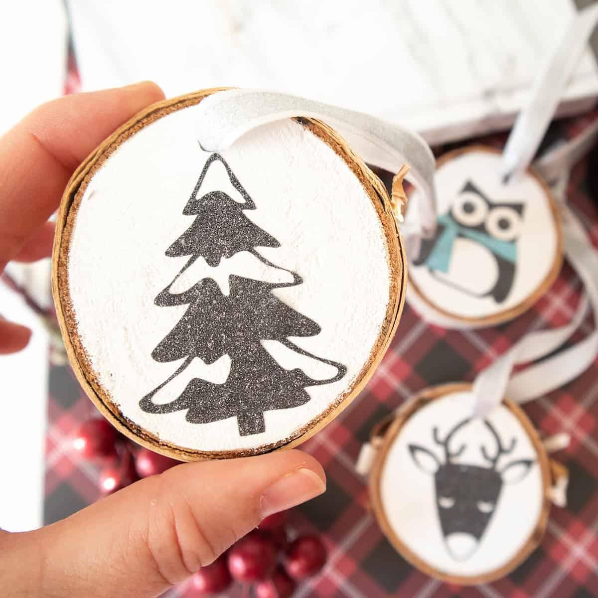 closeup of Glitter vinyl Christmas tree wood slice