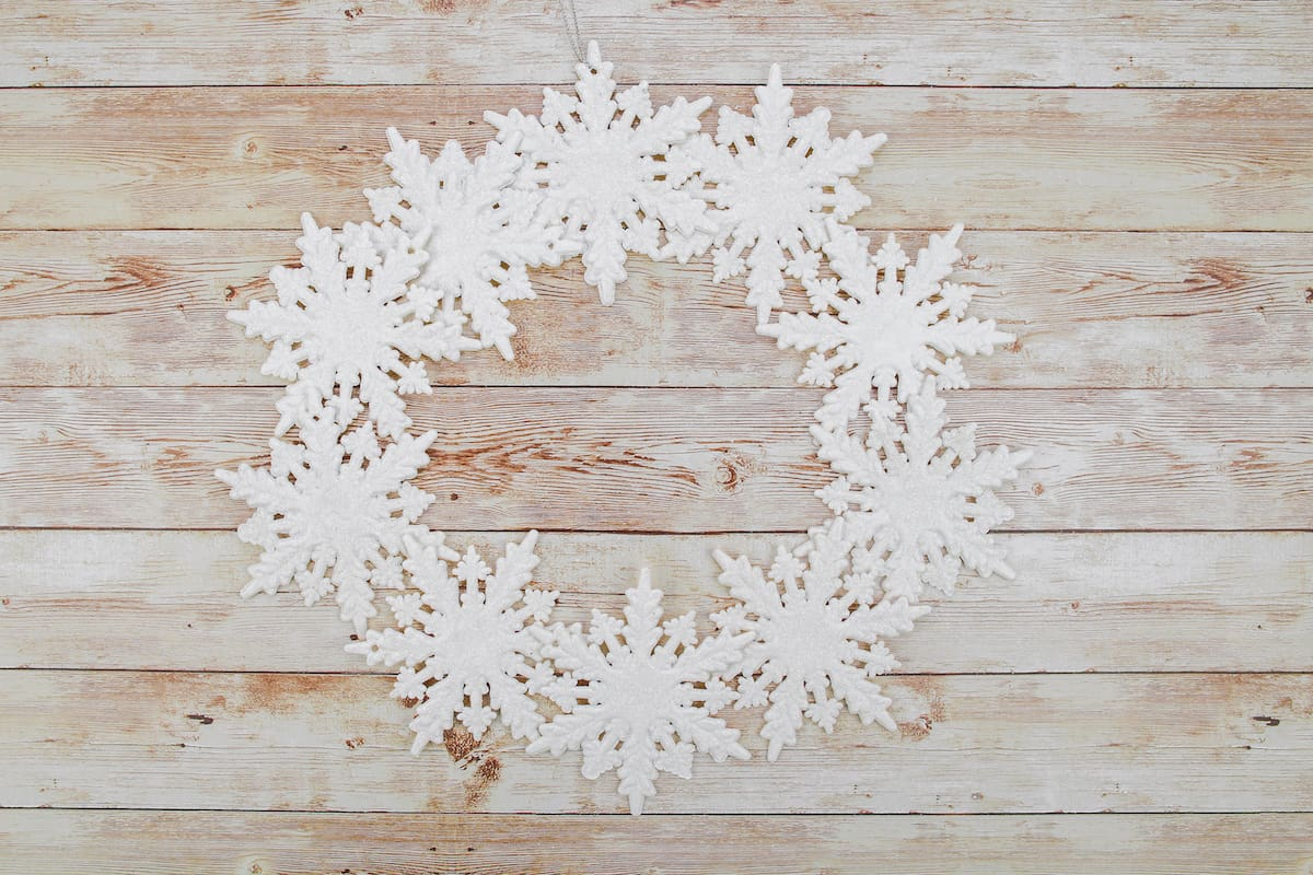 snowflake wreath on wooden table