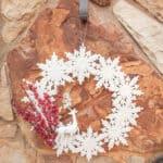 snowflake and deer Christmas Wreath on rock wall