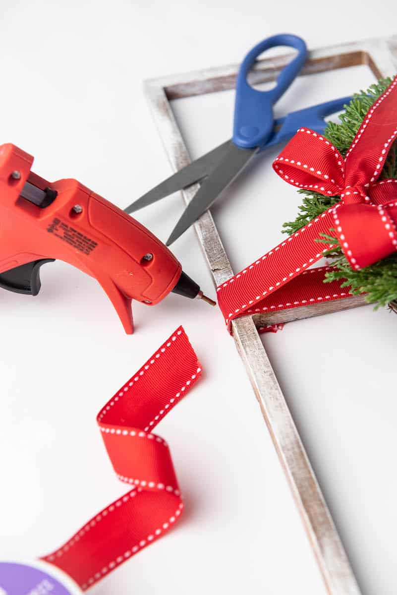 hot glueing ribbon to frame