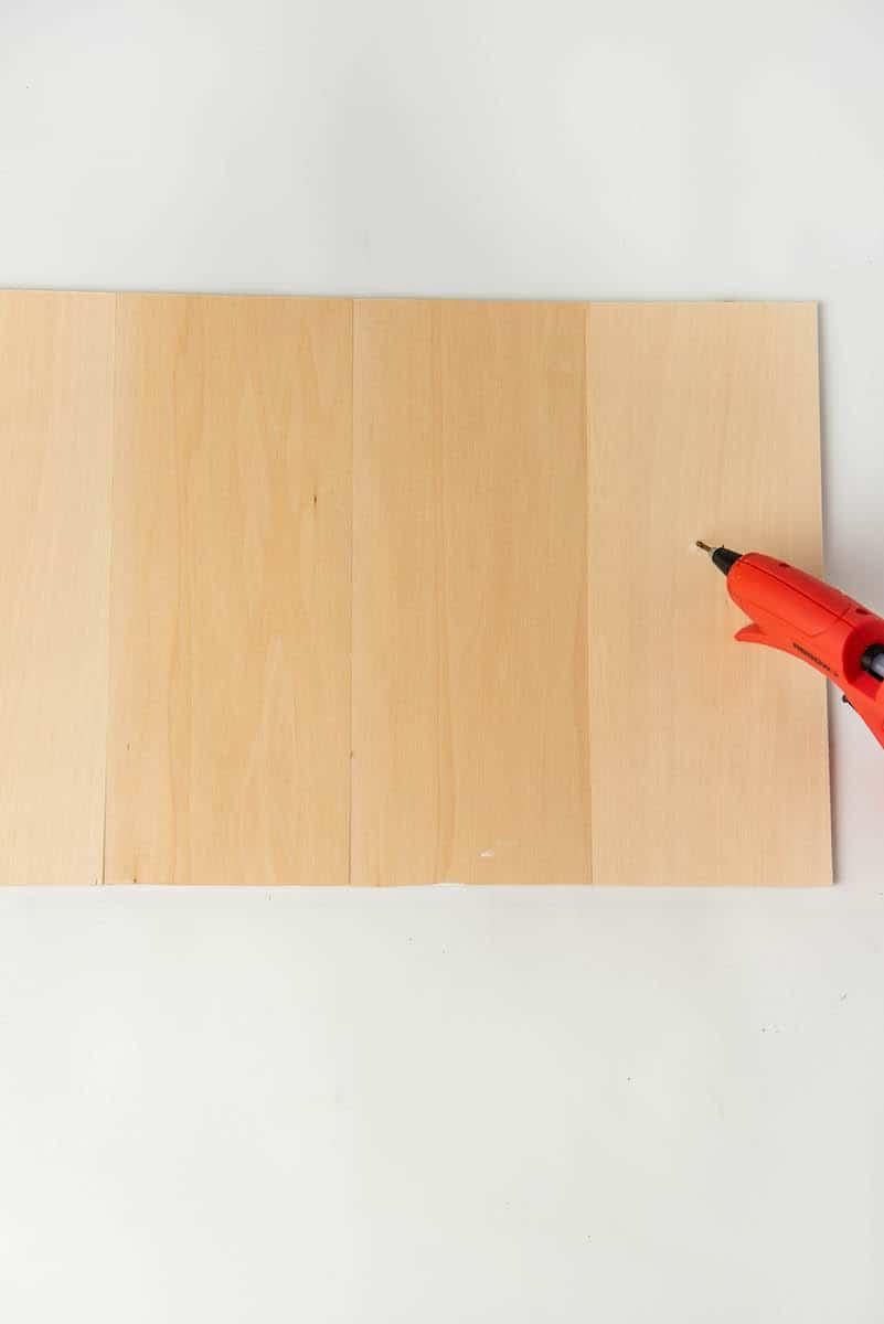 Hot glueing wood sign craft