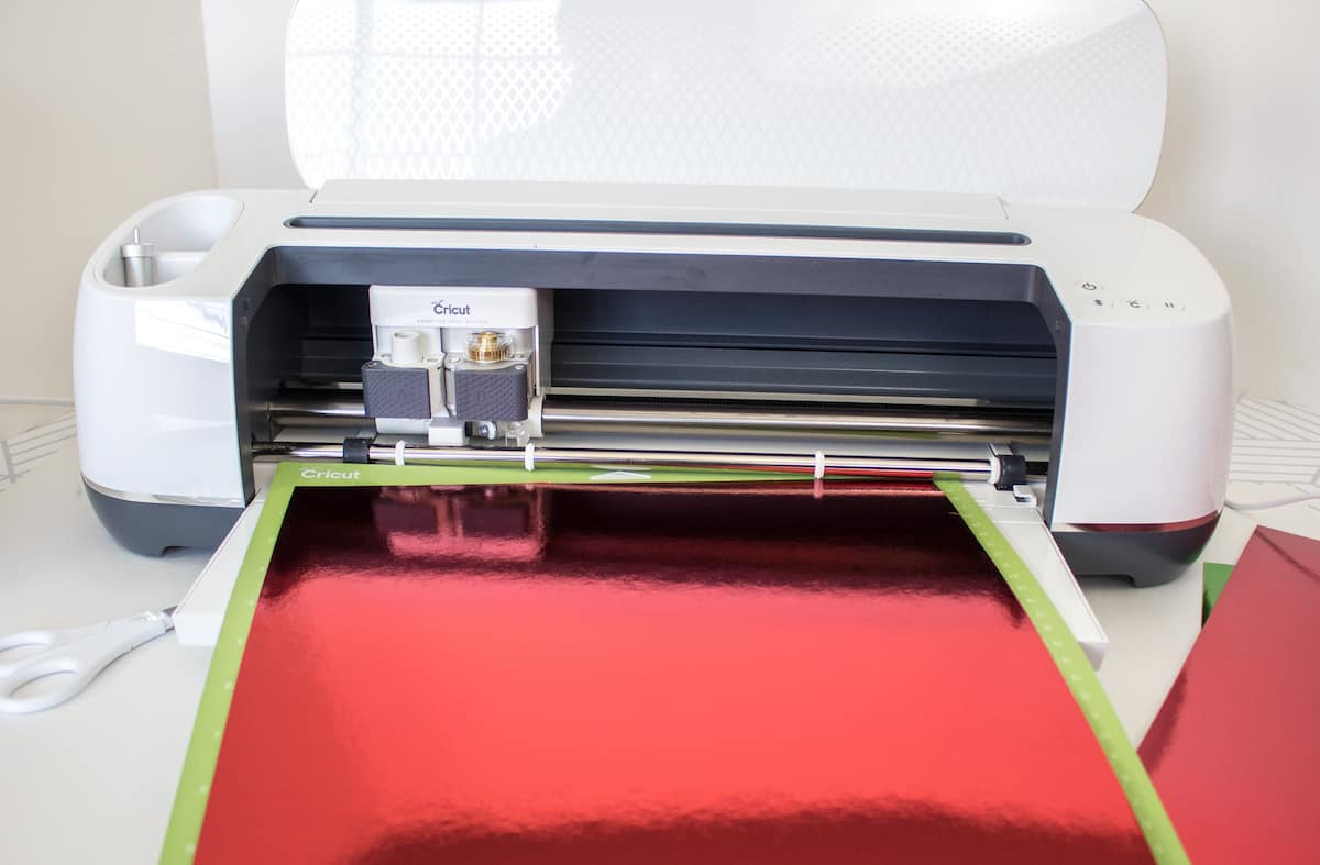 Cricut Machine with Red Foil Paper Loaded