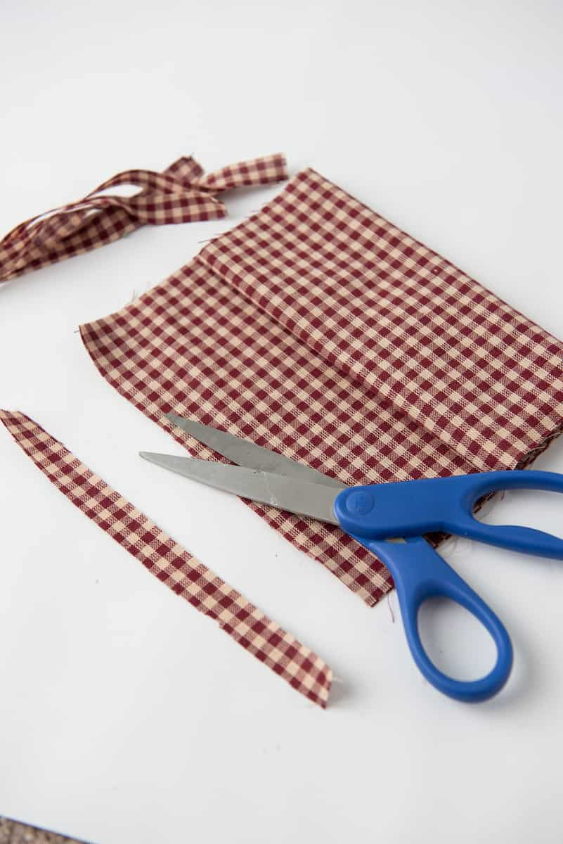 Cutting Checkered Fabric with Scissors