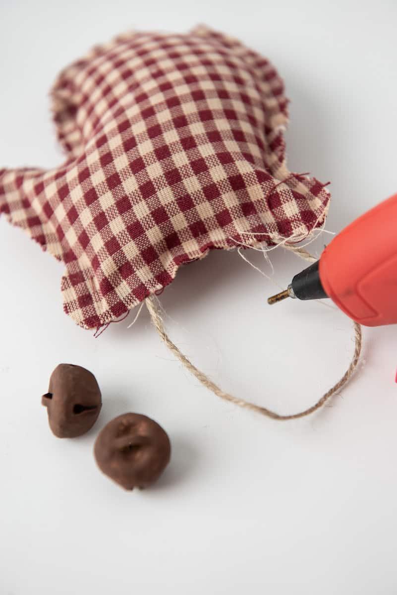 Glueing Twine to Mitten Craft Ornament