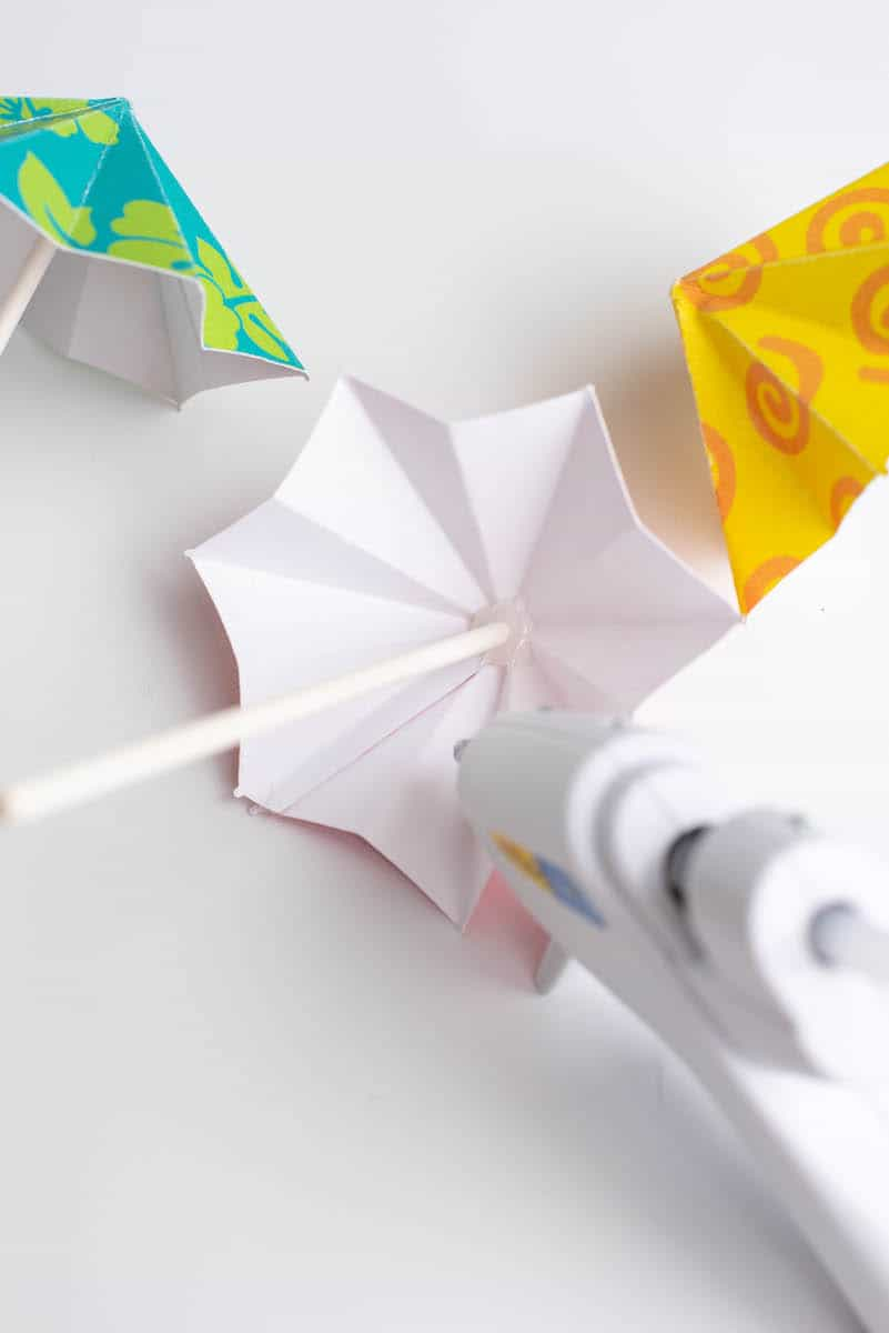 Glueing stick to drink umbrella