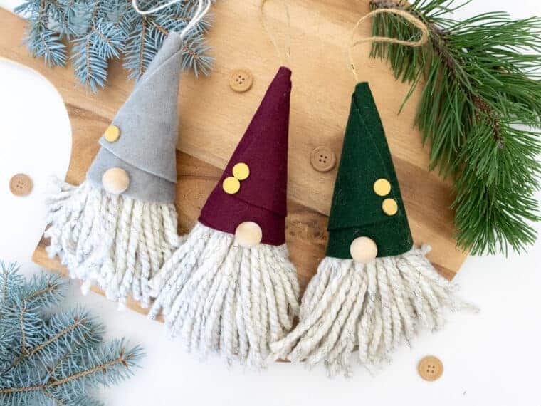 felt Gnome Ornaments on wooden background