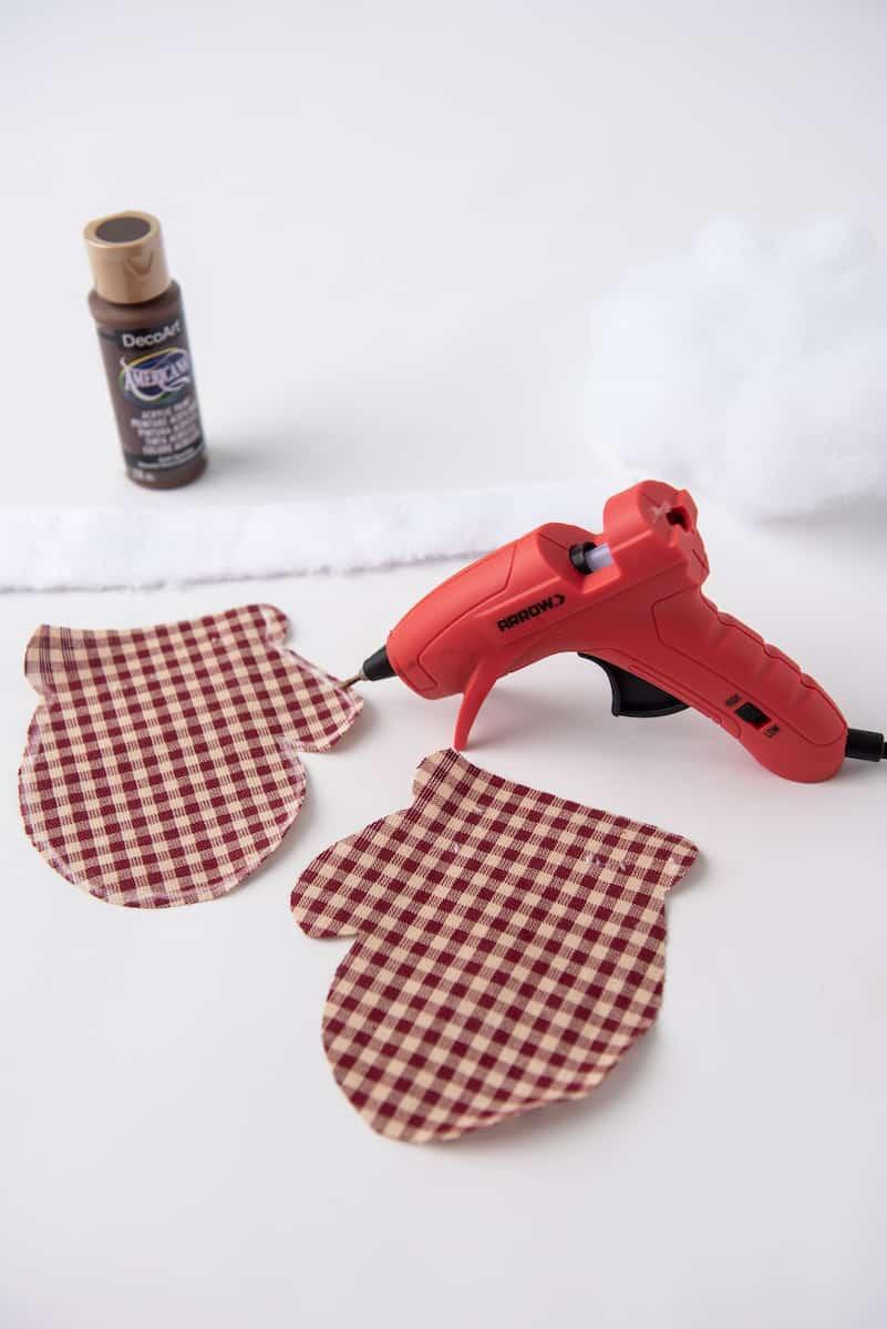 Hot Glueing Mitten Ornament Together