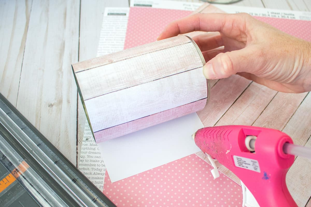 Hot Glueing Scrapbook Paper to Tin Can