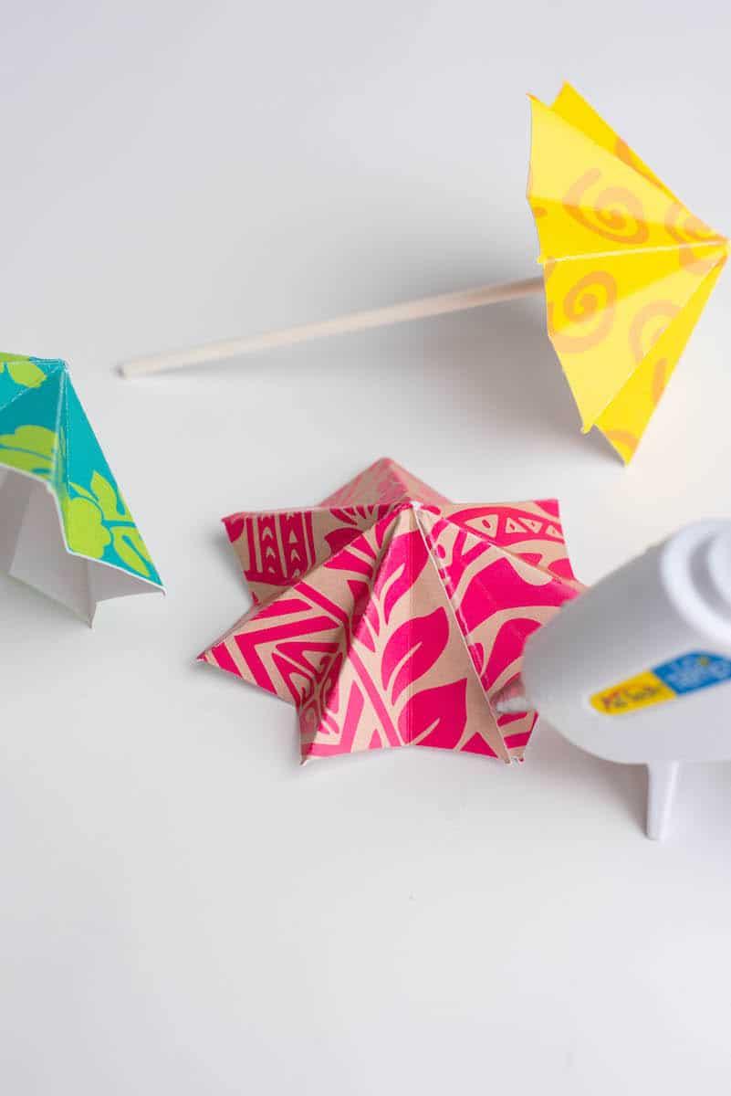 Hot glueing DIY drink umbrellas