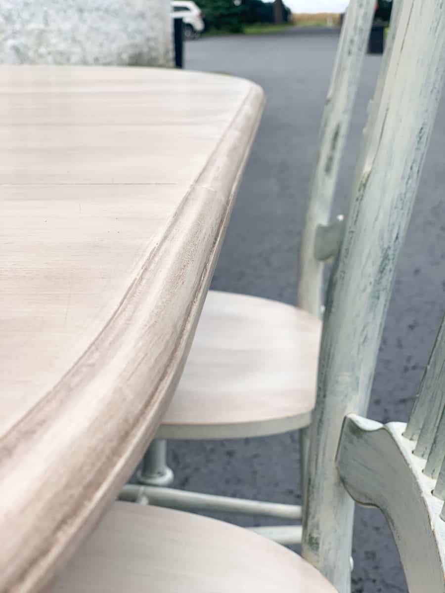 Edge of painted table and chairs