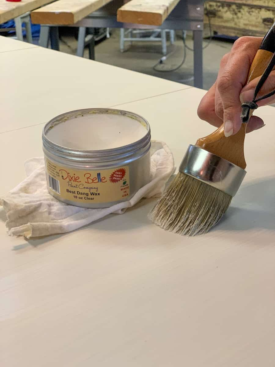 Painting table top with Dixie Belle Best Dang Wax in Clear
