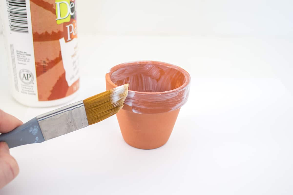 Painting terracotta pot with Mod Podge