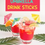 tiny umbrellas in drinks next to palm fronds