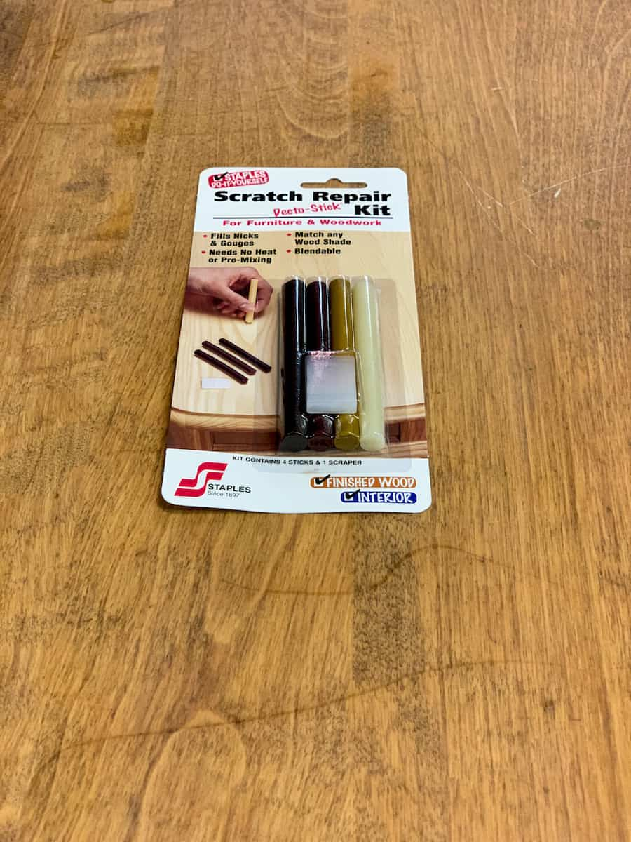 Wax table scratch repair kit on wooden table