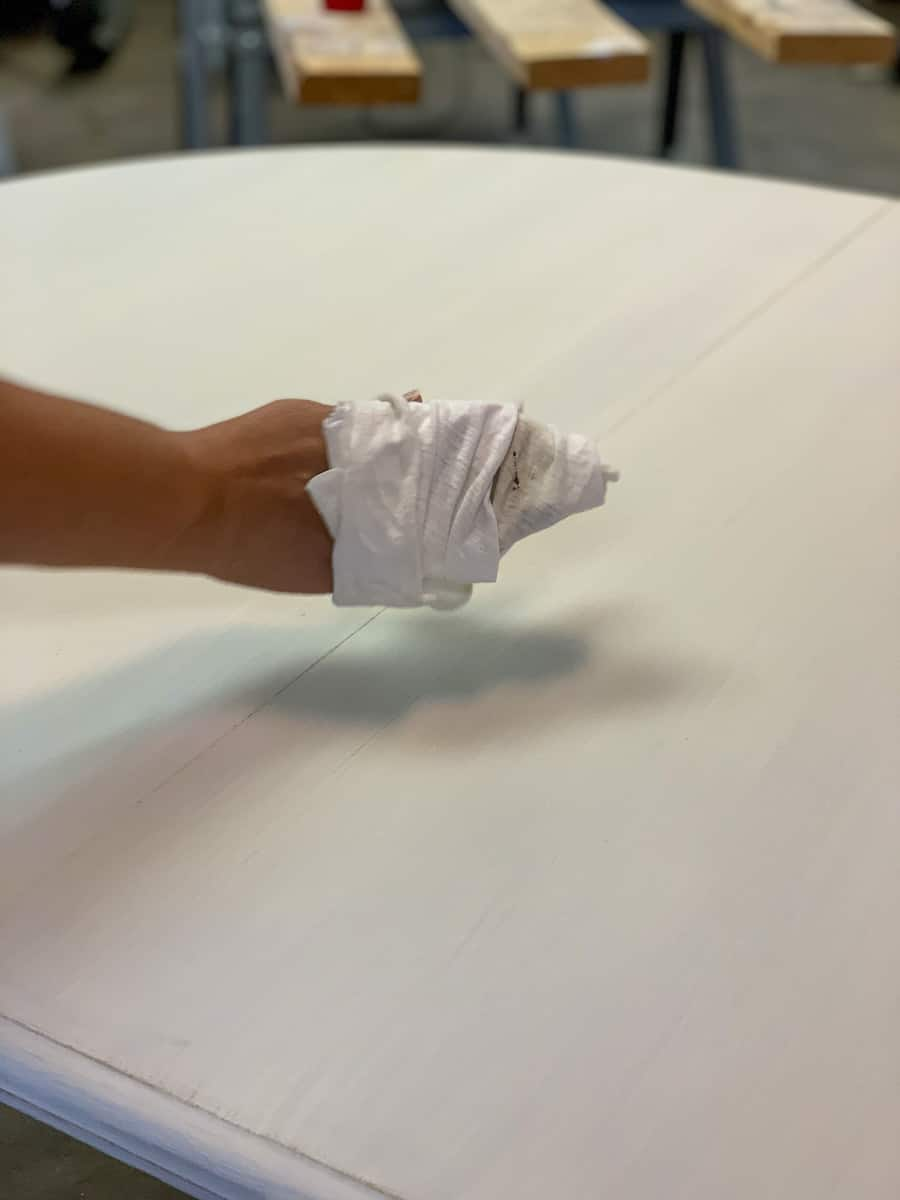 Wiping stain wax on table